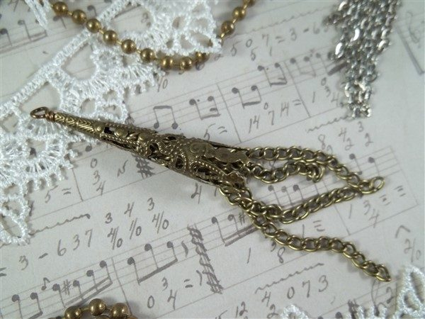 bronze filigree bead cap tassel by butterbeescraps