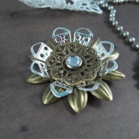 metal filigree flower embellishment by butterbeescraps