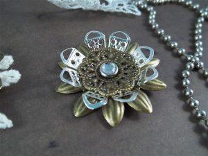 metal filigree flower embellishment by butterbeescraps