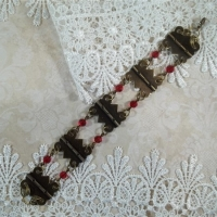 red and bronze hardware jewelry bracelet