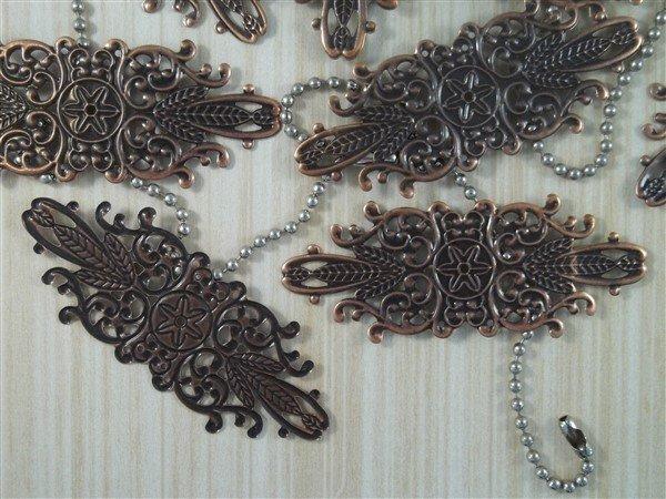 copper metal filigree embellishments by butterbeescraps