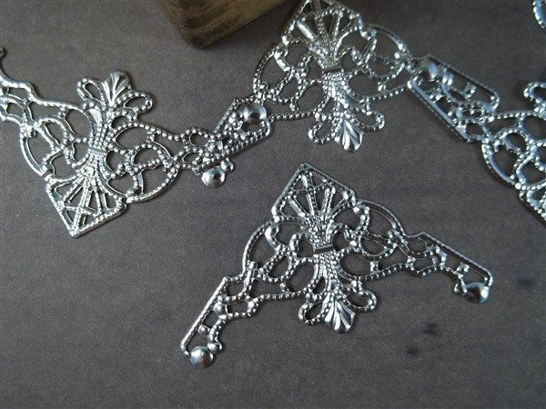 silver metal filigree embellishments by butterbeescraps