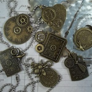 creative clocks tibetan charms by butterbeescraps