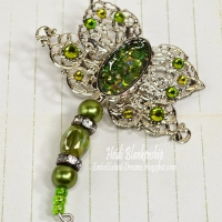 green crystal filigree dragonfly