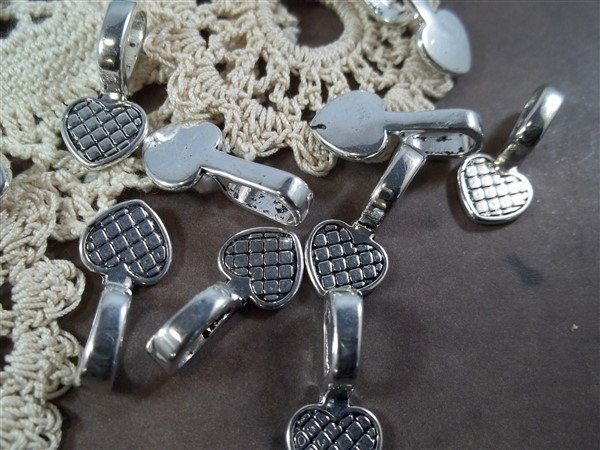 silver glue on bails by butterbeescraps