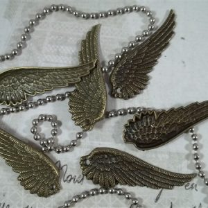bronze wing tibetan charms by butterbeescraps