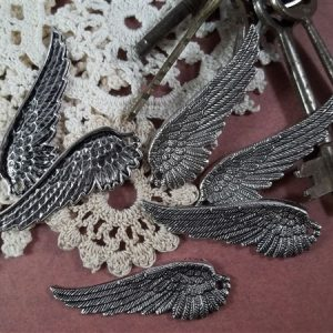 silver wing tibetan charms by butterbeescraps