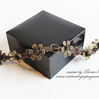 braided bracelet with bronze flower bead caps for butterbeescraps