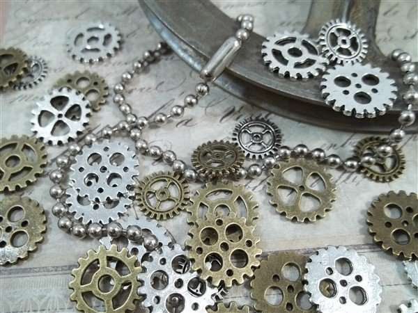 miniature mixed silver and bronze gear charms
