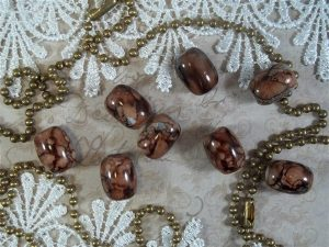 brown oval glass beads by butterbeescraps