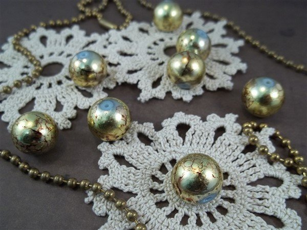 gold round glass beads by butterbeescraps