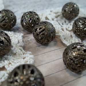 small bronze filigree beads by butterbeescraps