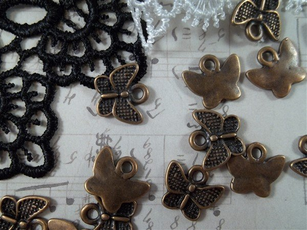 copper miniature butterfly tibetan charms by butterbeescraps
