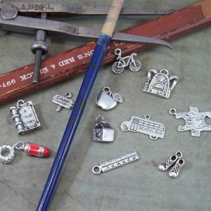 back to school tibetan charms by butterbeescraps
