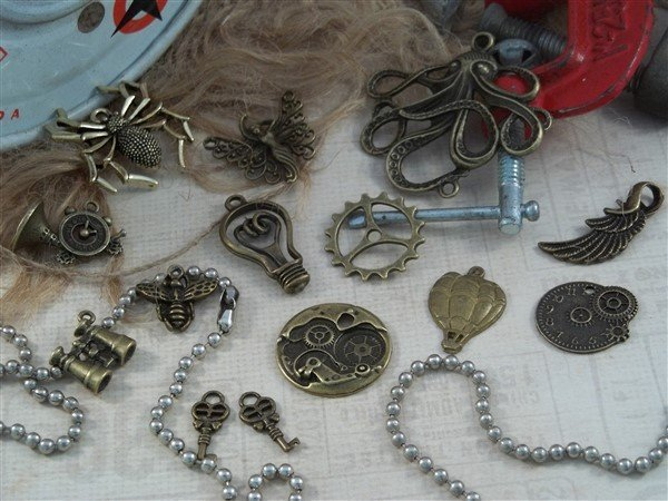 steampunk tibetan charms by butterbeescraps
