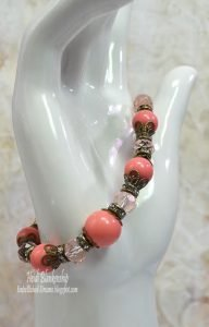 coral and bronze beaded bracelet