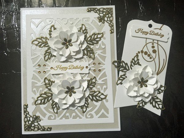 white birthday card and gift tag