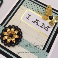 white blue and black card with gold metal filigree embellishments