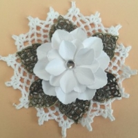 white flower with bronze filigree leaves