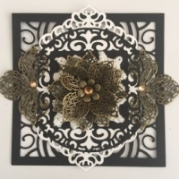 bronze black and white filigree scrapbooking embellishment