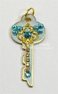 vintage key pendant with metal filigree