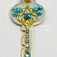 vintage key pendant with metal filigree