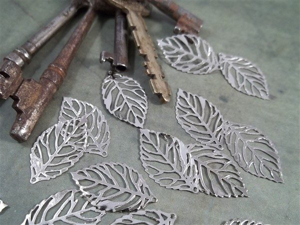 small silver skeleton leaf metal filigree embellishments