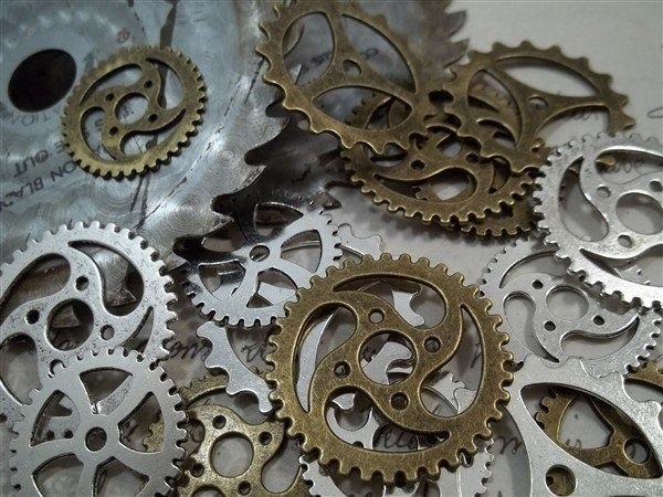 large silver and bronze gear charms