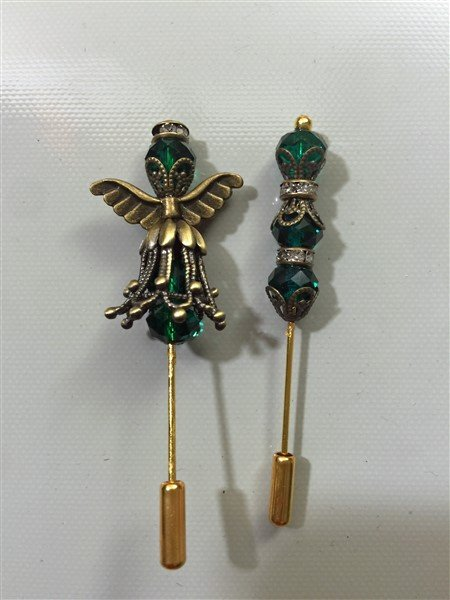 teal and bronze stick pin embellishments