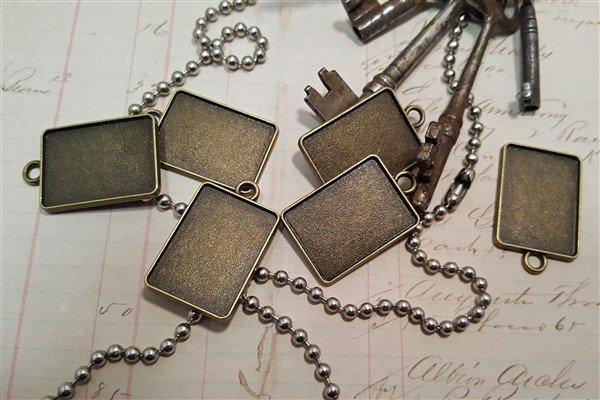small bronze rectangular bezel frames