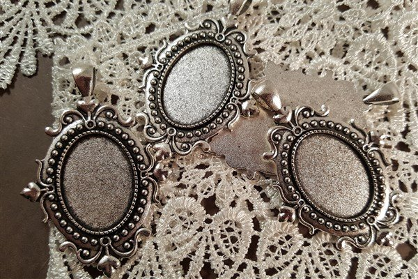 small silver oval cameo frames