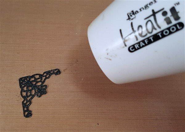 altering metal filigree embellishments using embossing powders