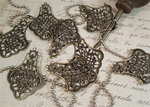 bronze metal filigree embellishment