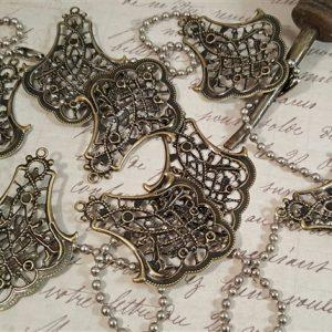 bronze metal filigree embellishment