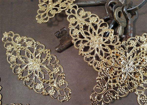 gold metal filigree embellishments