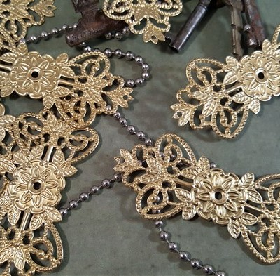 gold metal filigree embellishments