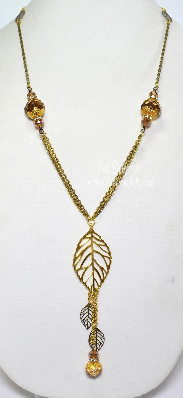 gold bronze leaf necklace by heidi blankenship